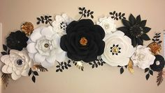 Beautiful and unique paper flowers backdrop, cut and individually assembled and shaped by hand. Made from premium card stock, they are ready to complete your next party decor. This arrangement include 12 flowers, range between 6 to 24: 3 x 24-26 2 x 14 2 x 12 3 x 10 2 x 6 6 leaves at your
