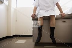 Front view of man on medical exam table Stock Photo