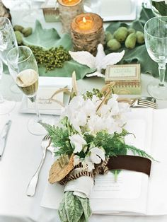 Earthy centerpieces with matching hues for an outdoor wedding. Romantic, classy look.