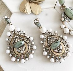 * Classic earrings on dark gold base. * Features pearls on the border and mixed stones on the surface. * An elegant style for day or night. Ear Piercings, Pearl Necklace, Jewels, Stone, Dark, Elegant, Earrings, Gold, Clothing