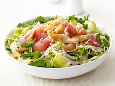Smoked Trout and Grapefruit Salad: Tart grapefruit pairs unexpectedly well with smoky trout, peppery greens and creamy dressing in this filling salad.