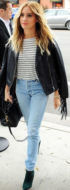 Who made  Ashley Tisdale's black leather handbag and fringe jacket?