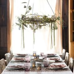 """Transform a favorite wreath into a striking chandelier with this adjustable, three-pronged hanger, found only at terrain. The expandable hooks hold the wreath horizontally above a table, where it can be embellished with seasonal blooms, garlands, and lights.- A terrain exclusive- Iron- Wipe clean with soft, dry cloth- Indoor or outdoor use- Imported30""""H, 4.5"""" diameter (closed)"""