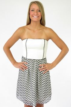 Show them a few things with this black and white chevron print tube dress with contrast piping.