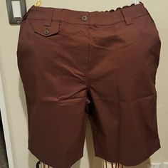 Susan Graver Brown twill dress shorts Cotton polyester spandex blend Brown twill shorts. Two front slash pockets and coin pocket with button flap. Zippered fly and elastic at the back of the waist. Inseam 11.5 inches. Brand new with tags and never worn. Susan Graver Shorts Bermudas