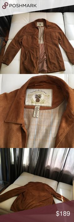 Tommy Bahama genuine Suede long coat. Size Large Tommy Bahama Paradise Nation Legendary suede coat with beautiful interior lining.  Camel or caramel colored suede exterior. Has two interior pockets button-down front. Size Large. Has some scuffs and light wear on the collar and cuffs which is normal for suede. This jacket is very clean overall and stored in a smoke free and pet free home. Marks shown are actually very small but enlarged in pics for you  Extremely soft & comfortable, a great…