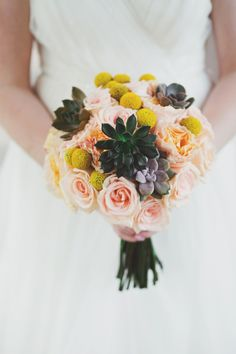 Peach, yellow, and succulent bouquet!! Love this!