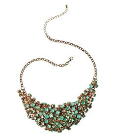 This is a WOW necklace. Clustered so randomly... perfectly... effortlessly... these brilliant rhinestones command attention.