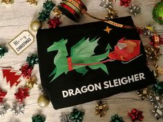 Christmas Jumpers with a Difference from the Jolly Christmas Jumper company. Including a review of a Dragon Sleigher one.