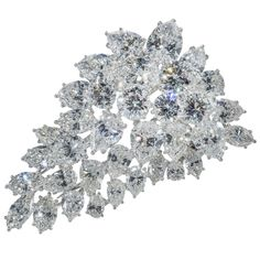 Spectacular Diamond Platinum Cluster Brooch | From a unique collection of vintage brooches at https://www.1stdibs.com/jewelry/brooches/brooches/