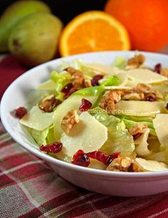 Green salad with iceberg lettuce, pear, cranberries, walnuts and parmesan