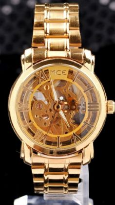 brand MCE!unisex golden Steel Luxury /AUTOMATIC Watch Gold Skeleton Mechanical watch original  (Size: 240MM*18MM*40MM, Color:(Gold)  Details  Condition: 100% Brand New  Band Material: High-quality stainless steel strap  Clasp: Stainless steel clasp  Movement : Automatical mechanical movement  Features: Time  Movement :Automatic-Self-Wind  Case Material :Stainless-Steel  Case Diameter :4.0cm  Case Thickness :1.0c  Band Material :Stainless-Steel  Band Length :22.0cm  Band Width :1.8cm…