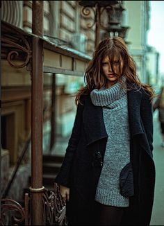 black coat + chunky gray turtleneck.