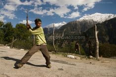 A young boy uses a dead branch for a bat in Sangla in Himachal, India. Beauty. These are the ones that catch my fancy!