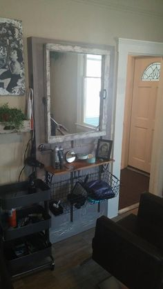 Kylie's station at Laughing Crow Salon. Door found at BRING recycling Shelf from recycled dresser with original hinges Mirror frame purposed from old window Plant shelf made from desk drawer
