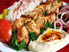 Chicken Kebab  Marinated chicken, rice, spiced onions, tomatoes, hummus and pickles  Mediterranean Armenian Food