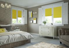 Bedroom with white shutters and yellow blinds