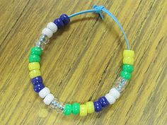 Water Cycle Bracelet: yellow=sun,green=land and plants, clear=evaporation,white=condensation and cloud formation, blue=precipitation, then the cycle repeats itself.....