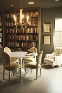 Why have a dining room when you can have a library with a dining room table.