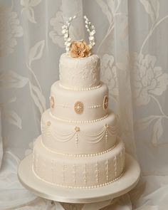 4 tier ivory and beige wedding cake inspired by the royal wedding cake.
