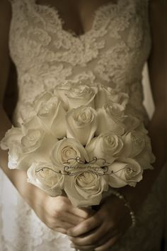 Simply stunning, cream roses and satin ribbon.  Flowers by Distinctive Designs by Denice  Photo by Tara Francis Photography