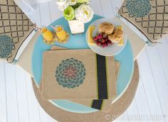 You deserve a pretty place to lay your plate. And that's why you'll want to add a set of chic hand-stenciled placemats to the top of your to-do list. Luckily, they're an easy DIY.