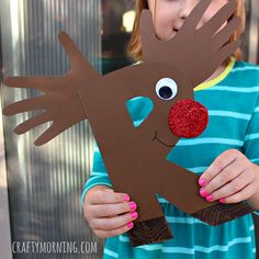 Have kids make rudolph the reindeer craft! It's a great christmas alphabet art project for preschoolers to make. R is for Reindeer.