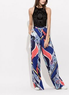 Try these roomy silk trousers for a comfortable low-impact workout.   Sporty Chic Outfits