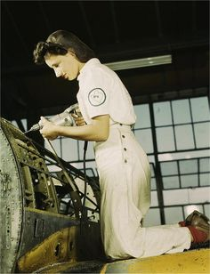 The Women Workers of WWII-- Oyida Peaks riveting. Photographed by Howard R. Hallem in August 1942.