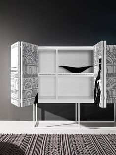 Hugo Pratt's original 1970s drawings of the sailing adventures of Corto Maltese have been reproduced on bookcases, containers, cabinets and table tops in DuPont™ Corian®.   design Manuela Pelizzon and Silvano Pierdonà photo courtesy of Capo D'Opera, all rights reserved