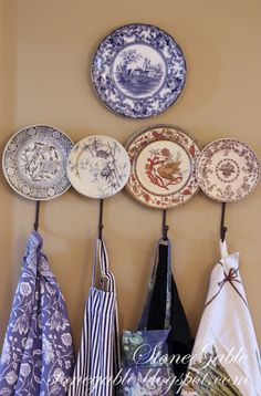 StoneGable: APRON STRINGS - Cute way to keep aprons handy; decorative plate hook; like it!