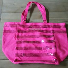 Victoria Secret Sparkly Tote Like new. 2 exterior pockets (one on each side). Large tote. Perfect for beach outing or to take to the gym. Victoria's Secret Bags Totes