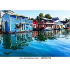 Floating Home Village Blue Red Brown Houseboats Fishermans Wharf Reflection Inner Harbor, Victoria British Columbia Canada Pacific Northwest...