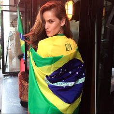 """Brazilian supermodel Izabel Goulart wrapped herself in a flag in this picture she posted to Instagram on June 17, 2014. """"GO BRAZIL!!!!! VAI BRASIL!!!!!"""" she wrote. """"Here in Paris ready to watch the game!!! Even been so far away from Brasil my heart is there cheering with my country!!"""""""