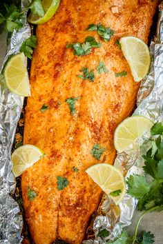 Learn how to bake salmon in foil with lime and chili for a tasty 30 minute meal that the whole family will love! #salmon #sheetpan #seafood