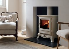 A think a wood-burning stove is a must. In cream, ideally.hate my horrid red brick fireplace(which is not working btw) looking for ideas of what if like it to look like. Gas Wood Burner, Wood Burner Fireplace, Fireplace Ideas, Gas Stove Fireplace, Electric Fireplace, Fireplace Design, My Living Room, Home And Living, Living Spaces