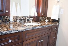 Black Marinace polished granite counter top with crystal vanity knobs-Kitchen + Bath | Design + Construction.