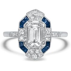This incredible platinum Art Deco reproduction ring features an emerald cut diamond surrounded by diamonds and French cut sapphire accents for a truly one-of-a-kind look (approx. Bijoux Art Deco, Art Deco Jewelry, Fine Jewelry, Jewelry Rings, Jewlery, Baby Jewelry, Art Nouveau, Art Deco Ring, Art Deco Diamond