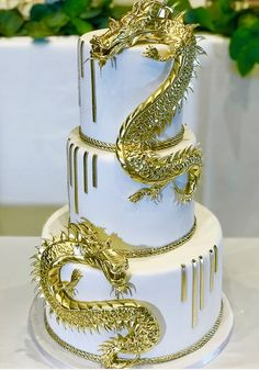 The Chic Technique:  Gold Dragons Adorn This Three-Tiered White Wedding Cake.