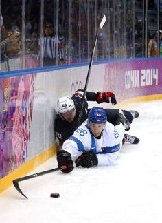 Lauri Korpikoski #28 of Finland goes for the puck against Ryan Suter #20 of the United States in the third period during the Men's Ice Hockey Bronze Medal Game (c) Getty Images