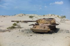 Destroyed and abandoned Russian-made army tank from the Civil War in Somaliland. War has left this part of Africa on it's knees for many decades Military Vehicles, 1980s, Abandoned, Africa, Army, Photos, Anos 80, Pictures, Military