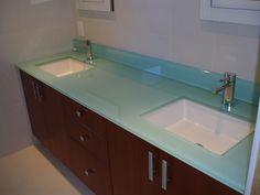Back-painted glass bathroom countertop with two white undermount sinks. #undermountsink #nkba