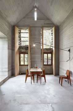 Cement + wood - love those floor length windows