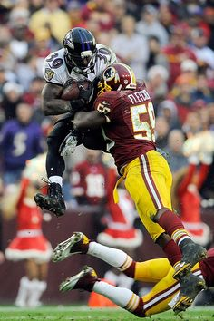 LANDOVER, MD - DECEMBER 09: Bernard Pierce #30 of the Baltimore Ravens leaps to avoid the tackle of DeAngelo Hall #23 and London Fletcher #59 of the Washington Redskins during a game at FedExField on December 9, 2012 in Landover, Maryland. (Photo by Patrick McDermott/Getty Images)
