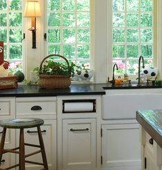 Decorating and Design Tips from Louise Brooks - Traditional Home®--love the windows and the paper towel under the counter