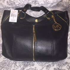 """Michael Kors black Moxley bag, new Authentic MK medium black leather shoulder tote, Moxley style. Gold hardware, zipper accents. Magnetic snap closure. Interior zip, wall, and cell phone pockets. Logo-jacquard lining. New with tag. Will come with dust bag. Bought for myself but never used due to having another MK bag I use more. Measurements: 16.2""""X11.4""""x2"""".  Original price reflects product price plus tax. Michael Kors Bags Shoulder Bags"""