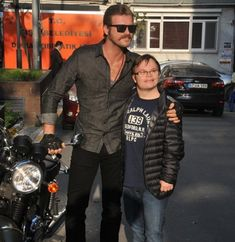He is smiling. Actor Model, Turkish Actors, Mens Sunglasses, Bomber Jacket, Handsome, Punk, Movies, Jackets, Tops