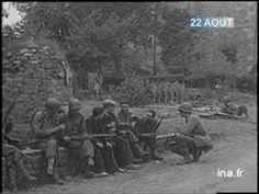 22 août 1944: Des soldats américains trouvent du réconfort auprès d'habitants de Larchamp dans l'Orne, qui leur offrent un rafraîchissement.