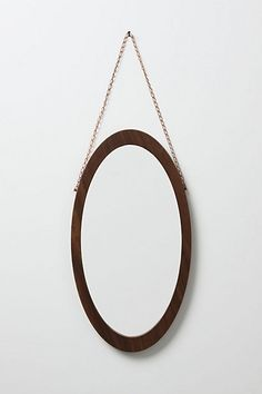 Walnut oval Mirror, love the small chain from which it hangs