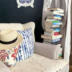 Lovely stack of books and reading chair by Pebble Hill Design